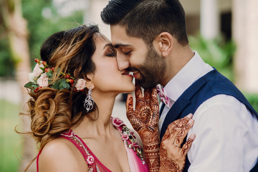 Indian bride and groom sharing a kiss