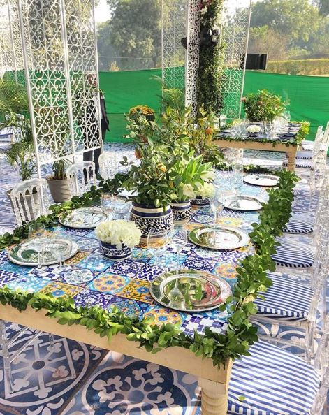 Blue tile table accented by greenery