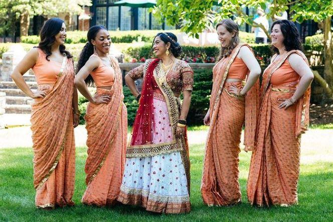 Bridesmaids in orange saris