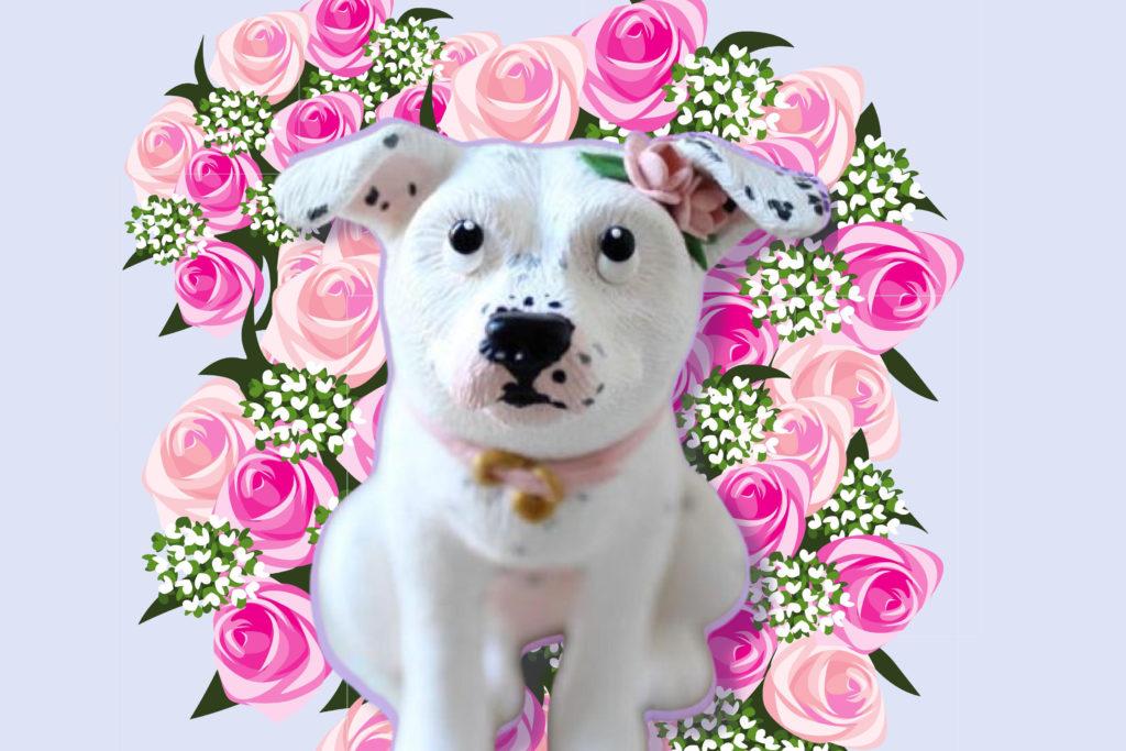 Dog wedding cake topper over floral background